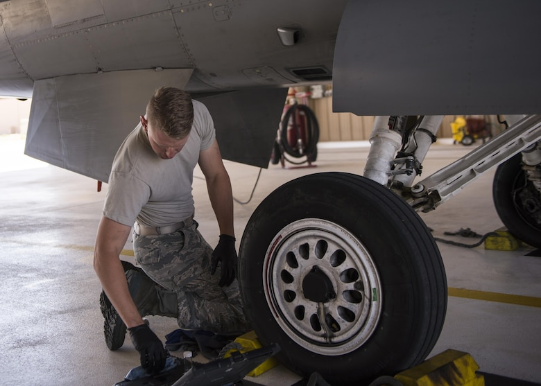 Airman 1st Class Derek King, a 54th Aircraft Maintenance Unit F-16 crew chief, performs maintenance on an F-16 Fighting Falcon at Holloman Air Force Base, N.M. on May 3, 2017. The 54th AMU runs 24 hour operations. Therefore, Holloman's maintenance Airmen work round-the-clock to keep these aircraft operable and flying. (U.S. Air Force photo by Airman 1st Class Alexis P. Docherty)