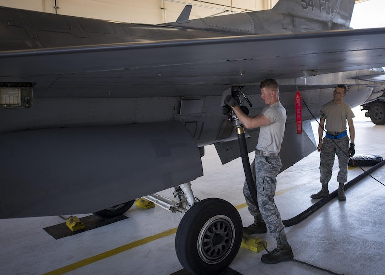 Airman 1st Class Derek King, a 54th Aircraft Maintenance Unit F-16 crew chief, refuels an F-16 Fighting Falcon following a recovery operation at Holloman Air Force Base, N.M. on May 4, 2017. The 54th AMU runs 24 hour operations. Therefore, Holloman's maintenance Airmen work round-the-clock to keep these aircraft operable, performing a variety of mechanical and technical duties. (U.S. Air Force photo by Airman 1st Class Alexis P. Docherty)