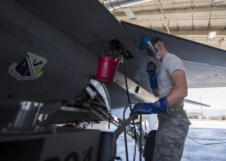 Airman 1st Class Derek King, a 54th Aircraft Maintenance Unit F-16 crew chief, performs recovery operations on an F-16 Fighting Falcon at Holloman Air Force Base, N.M. on May 4, 2017. Crew chiefs perform a variety of maintenance tasks from oil servicing and tire checks to readying a jet for flight. (U.S. Air Force photo by Airman 1st Class Alexis P. Docherty)