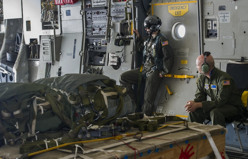Leon Logothetis, right, TV personality and author of The Kindness Diaries, and Senior Airman Ashley Igalo, left, 14th Airlift Squadron loadmaster, look out the bay door of a C-17 Globmaster III during Logothetis's visit to Joint Base Charleston, S.C., May 5, 2017. Logothetis said his message of kindness aligns with JB Charleston's humanitarian missions.