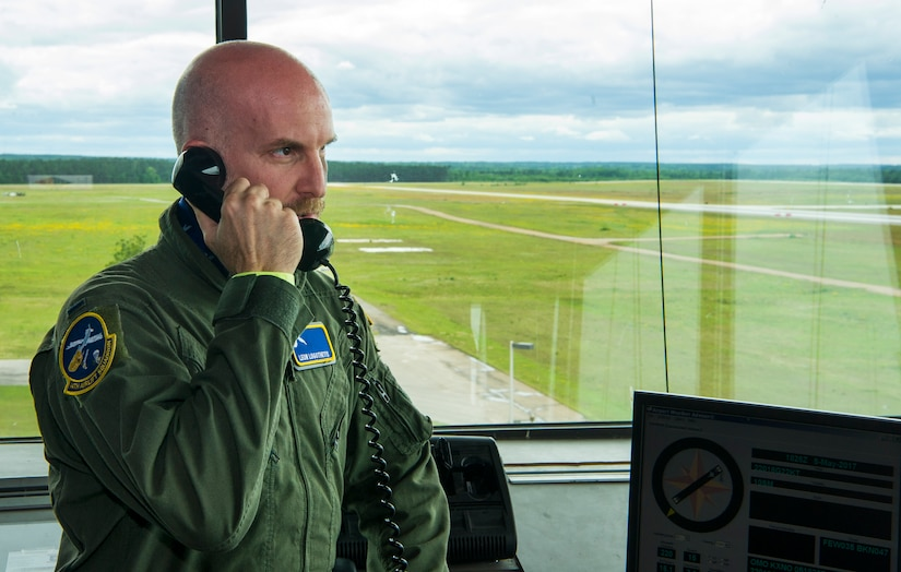 Leon Logothetis, TV personality and author of The Kindness Diaries, talks on the phone with C-17 Globemaster III pilots during his visit to Joint Base Charleston, S.C., May 5, 2017. Logothetis toured the base and received demonstrations from different squadrons.
