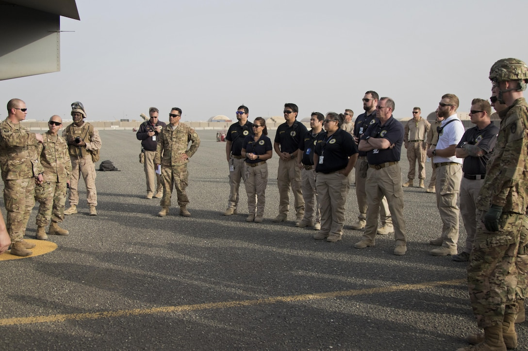 U.S. Army combat medics, with the 86th Combat Support Hospital, and Emergency Medical Technicians, with Area Support Group - Kuwait Joint Emergency Service, receive a safety brief before familiarizing themselves with personnel recovery drills during a joint training exercise with Marines from Marine Medium Tiltrotor Squadron - 364 (VMM-364), at Camp Arifjan, Kuwait, May 8, 2017. (U.S. Army photo by Staff Sgt. Dalton Smith)