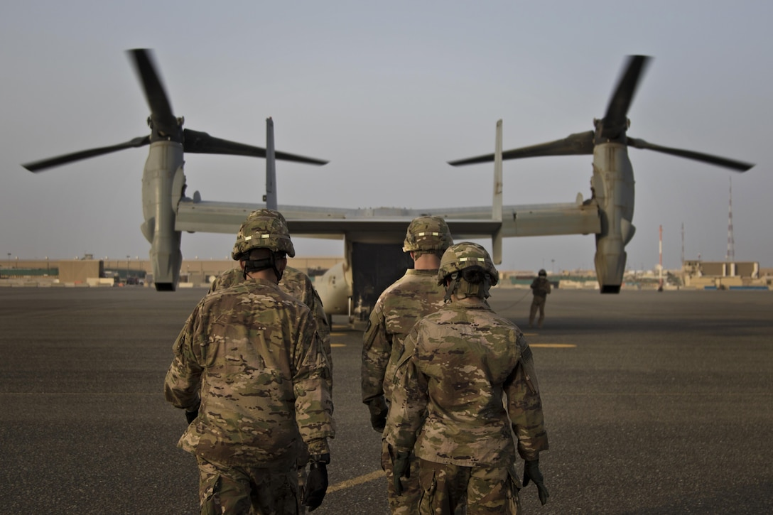 U.S. Army combat medics, with the 86th Combat Support Hospital, approach a MV-22 Osprey during a joint training exercise with Marines from Marine Medium Tiltrotor Squadron - 364 (VMM-364), at Camp Arifjan, Kuwait, May 8, 2017. (U.S. Army photo by Staff Sgt. Dalton Smith)