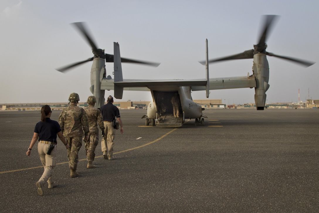 U.S. Army combat medics, with the 86th Combat Support Hospital, and Emergency Medical Technicians, with Area Support Group - Kuwait Joint Emergency Service, approach a MV-22 Osprey during a joint training exercise with Marines from Marine Medium Tiltrotor Squadron - 364 (VMM-364), at Camp Arifjan, Kuwait, May 8, 2017. (U.S. Army photo by Staff Sgt. Dalton Smith)