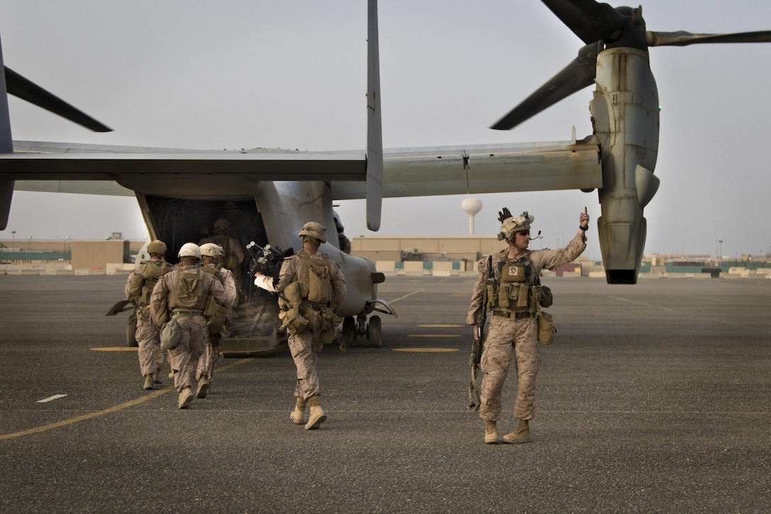 U.S. Marines ingress on to a MV-22 Osprey after a joint training exercise with Marines from Marine Medium Tiltrotor Squadron - 364 (VMM-364) and U.S. Army combat medics, with the 86th Combat Support Hospital, at Camp Arifjan, Kuwait, May 8, 2017. (U.S. Army photo by Staff Sgt. Dalton Smith)