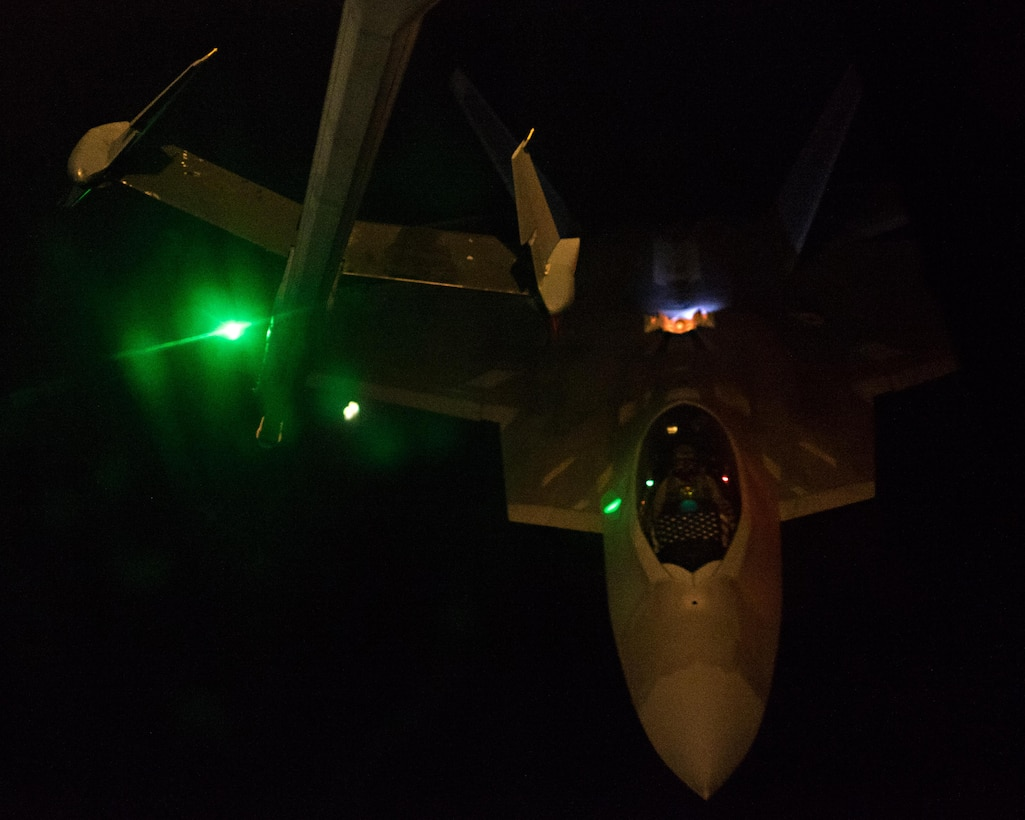 Lt. Col. Shell, 27th Fighter Squadron commander, pilots an F-22A Raptor toward a KC-10 Extender boom May 2, 2017, over an undisclosed location in southwest Asia. The 27 EFS reaches its 100th anniversary May 8, 2017. (U.S. Air Force photo by Senior Airman Preston Webb)