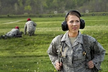 Senior Airman Jayci Cloutier, 434th Aerospace Medicine Squadron medic, poses for a photo at a firing range on Camp Atterburry-Muscatatuck, Indiana, April 20, 2017. Cloutier was the stand-by medical responsible for providing emergency medical care during a 434th Security Forces Training exercise. (U.S. Air Force photo/Senior Airman Cali Wetli)
