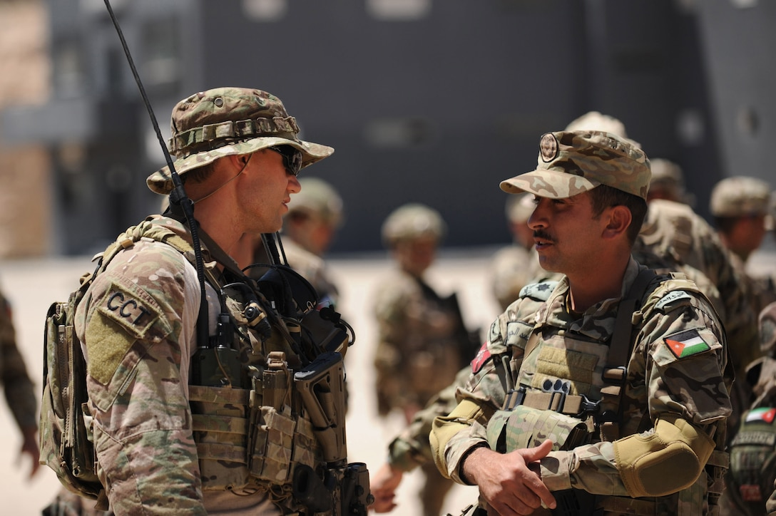 AMMAN, Jordan (May 7, 2017) An Air Force Special Tactics Officer, assigned to personnel recovery troop 2350, discusses safety procedures with a Jordanian Armed Forces Special Task Force Officer, during an interoperability fast rope suspension exercise, at the King Abdullah II Special Operations Training Center, as part of Exercise Eager Lion. Eager Lion is an annual U.S. Central Command exercise in Jordan designed to strengthen military-to-military relationships between the U.S., Jordan and other international partners. This year's iteration is comprised of about 7,200 military personnel from more than 20 nations that will respond to scenarios involving border security, command and control, cyber defense and battlespace management. (U.S. Navy photo by Mass Communication Specialist 1st Class Matthew Cole/Released) 170507-N-ER662-122