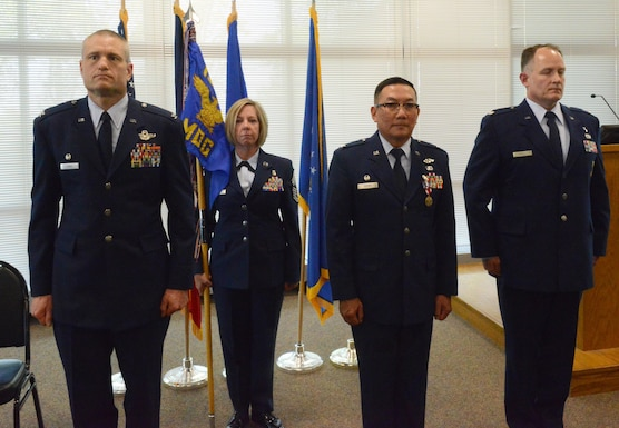 (Left to right) Col. Shawn D. Ford, Commander 132nd Wing (132 WG), Chief Master Sgt. Kris A. Rode, Medical Group (MDG) superintendent, Col. Jim P. Duong, outgoing MDG commander and Lt. Col. Chad M. Hynnek, incoming MDG commander stand at attention during the change of command ceremony at the 132 WG, Des Moines, Iowa on May 7, 2017. Duong served as the commander of the MDG for almost five years. (U.S. Air National Guard photo by Airman 1st Class Katelyn Sprott)