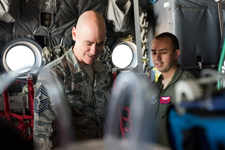 Chief Master Sgt. Ronald C. Anderson, command chief master sergeant of the Air National Guard, asks Staff Sgt. Aaron Rickey, a 137th Aeromedical Evacuation Squadron flight instructor, about equipment used by AES Airmen during a tour of the 137th Special Operations Wing at Will Rogers Air National Guard Base in Oklahoma City, May 8, 2017. The tour allowed Lt. Gen. L. Scott Rice, the director of the Air National Guard, and several other distinguished visitors to not only get a look into the special operations mission of the 137 SOW but also find ways to better serve the Airmen of the Air National Guard. (U.S. Air Force photo by Staff Sgt. Kasey Phipps)