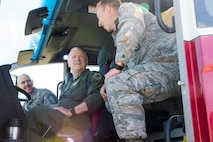 Staff Sgt. Eddie Myers, 137th Fire Department airman, demonstrates the capabilites of the department's Oshkosh Striker aircraft rescue and firefighting vehicle to Lt. Gen. L. Scott Rice, director of the Air National Guard, and Chief Master Sgt. Ronald C. Anderson, command chief master sergeant of the Air National Guard, during a tour of the 137th Special Operations Wing at Will Rogers Air National Guard Base in Oklahoma City, May 7, 2017. The tour allowed the director and several other distinguished visitors to not only get a look into the special operations mission of the 137 SOW but also find ways to better serve the Airmen of the Air National Guard. (U.S. Air Force photo by Staff Sgt. Kasey Phipps)