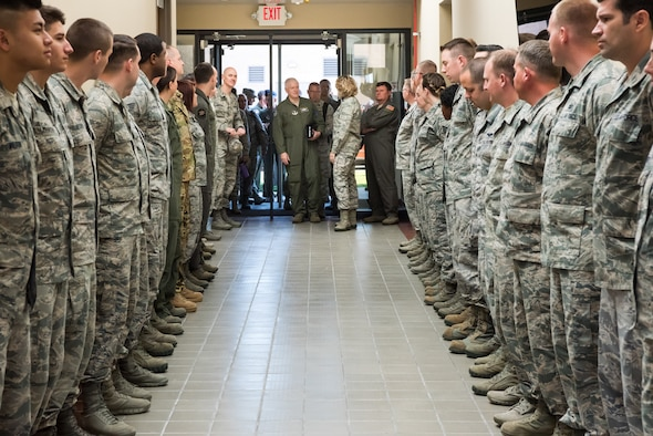 Lt. Col. Shelby Dreyer, 285th Special Operations Intelligence Squadron commander, introduces Lt. Gen. L. Scott Rice, director of the Air National Guard, to Airmen during a tour of the 137th Special Operations Wing at Will Rogers Air National Guard Base in Oklahoma City, May 7, 2017. The tour allowed the director and several other distinguished visitors to not only get a look into the special operations mission of the 137 SOW but also find ways to better serve the Airmen of the Air National Guard. (U.S. Air Force photo by Staff Sgt. Kasey Phipps)