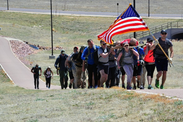 Participants march to the top of the final hill during the Team Cohesion Challenge at Schriever Air Force Base, Colorado, Friday, May 5, 2017. More than 35 Team Schriever members participated in the grueling, five-hour event. (U.S. Air Force photo/Brian Hagberg)