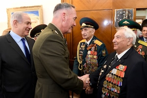 Marine Corps Gen. Joe Dunford, chairman of the Joint Chiefs of Staff, shakes hands with a World War II veteran during a meeting with Israeli Prime Minister Benjamin Netanyahu in Jerusalem, May 9, 2017. DoD photo by Matty Stern