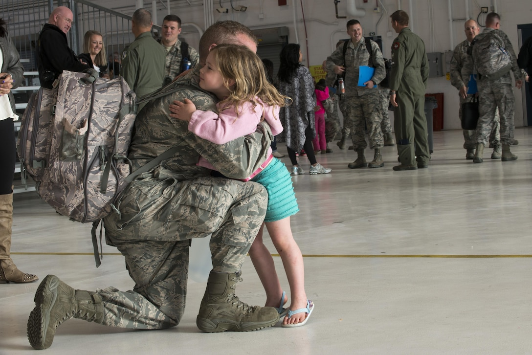 Senior Airman Kevin Isaac from the Colorado Air National Guard's 140th Aircraft Maintenance Squadron, says goodbye to his daughter Alysaa before he departs from Buckley AFB, Colo., May 5, 2017. Approximately 250 Airmen from the Colorado Air National Guard's 140th Wing along with 12 F-16 Fighting Falcons are departing to Kadena Air Base, Japan for a deployment in support of the U.S. Pacific Command Theater Security Package.   (U.S. Air National Guard photo by Master Sgt. Wolfram M. Stumpf/Released)