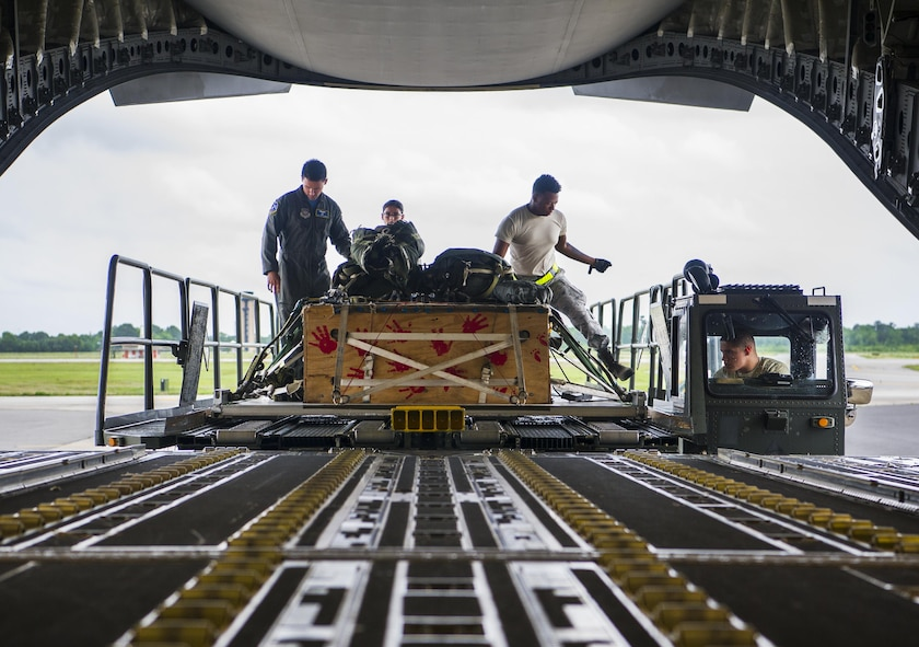 Loadmasters from the 14th Airlift Squadron load cargo into the bay of a C-17 Globemaster III during a training exercise at Joint Base Charleston, S.C., May 5, 2017. The 14th Airlift Squadron, 437th Airlift Wing, provides combat-ready aircrews for worldwide, direct-delivery airlift supporting rapid global mobility efforts of the Air Force.