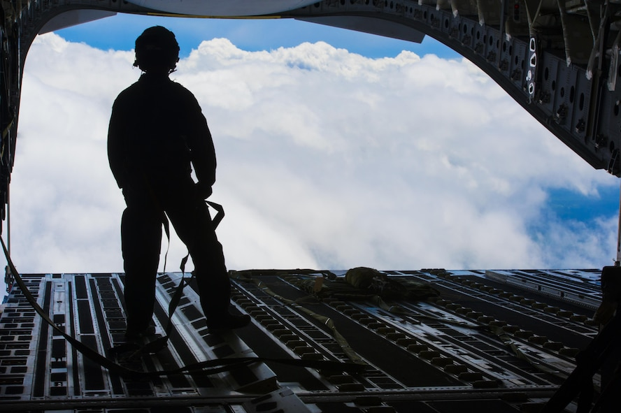 Tech. Sgt. Casey Dover, 14th Airlift Squadron NCO in charge of current operations, looks out of the cargo door of a C-17 Globemaster III before a cargo drop training exercise at Joint Base Charleston, S.C., May 5, 2017. Loadmasters are charged with supervising the loading and unloading of cargo, vehicles and people on aircrafts.