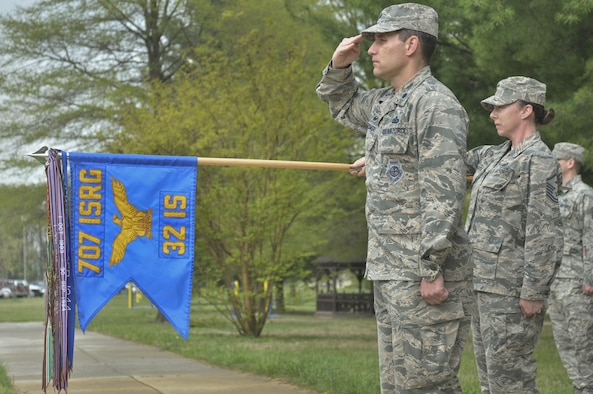 Col. Paul Rozumski, 32nd Intelligence Squadron commander, and Master Sgt. Emily Mandarich, 32nd IS first sergeant, hold their salutes April 20 during the annual retreat ceremony in honor of members of the 32nd IS during World War II.  (U.S. Air Force photo by Tech. Sgt. Mark Thompson)