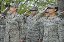Airmen from the 32nd Intelligence Squadron hold their salutes April 20 during the annual retreat ceremony in honor of the members of the 32nd IS during World War II. (U.S. Air Force photo by Tech. Sgt. Mark Thompson)