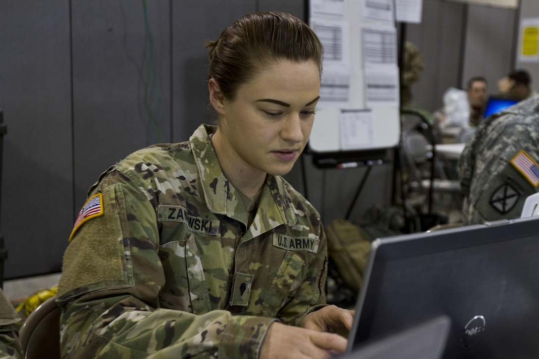 Spc. Jillian L. Zaniewski, a U.S. Army Reserve human resource specialist assigned to Task Force 76 out of Salt Lake City, works on personnel actions during Vibrant Response 17 at Camp Atterbury, Ind., May 7, 2017. Vibrant Response 17 is an annual command post exercise that simulates the detonation of a nuclear bomb in a major city within the United States. This year it was integrated with Guardian Response 17 at Muscatatuck Urban Training Center, Indiana. The exercises enable emergency response organizations, both civilian and military, to integrate and provide relief during a catastrophic disaster. (U.S. Army Reserve Photo by Sgt. Stephanie Ramirez)
