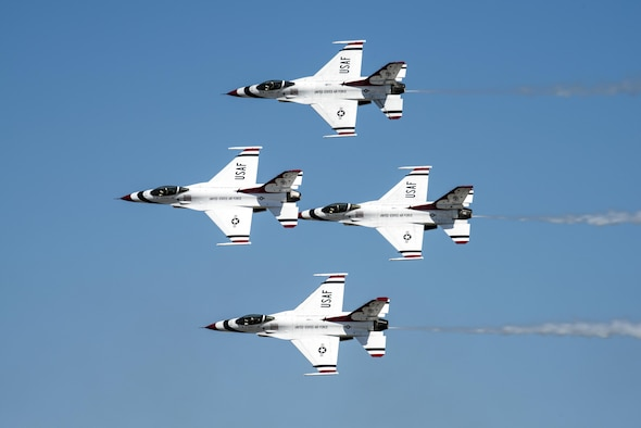 The U.S. Air Force Thunderbirds perform an aerial demonstration during the Wings over Solano Air Show at Travis Air Force Base, Calif., May 7, 2017. The two-day event also featured performances by the U.S. Army Golden Knights parachute team, flyovers and static displays. (U.S. Air Force photo by David Cushman)