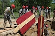 A crew of 468th Fire Fighting Detachment Soldiers shore up the side of a trench in order to extract a mannequin casualty safely during Guardian Response 17 at Muscatatuck Urban Training Center, Indiana on May 7, 2017.   Nearly 5,000 Soldiers and Airmen from across the country are participating in Guardian Response 17, a multi-component training exercise to validate the military's ability to support Civil Authorities in the event of a Chemical, Biological, Radiological, and Nuclear (CBRN) catastrophe. (U.S. Army Reserve photo by Staff Sgt. Christopher Sofia/Released)