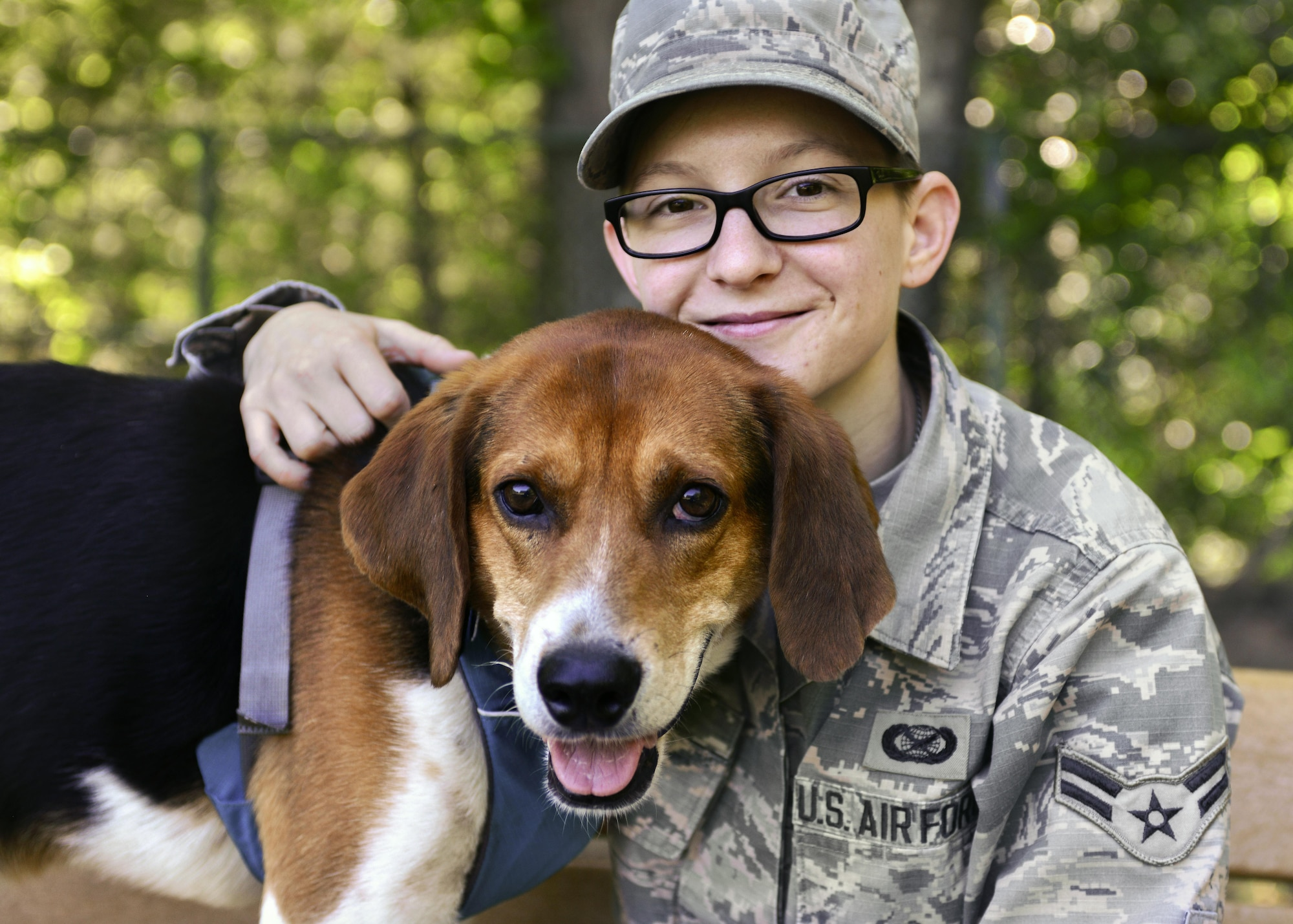 """U.S. Air Force Airman 1st Class Kaylee Dubois, 633rd Air Base Wing Public Affairs photojournalist, spends time with her dog, Watson, at Joint Base Langley-Eustis, Va., May 9, 2017. Dubois spent roughly seven months in mental health treatment programs, and once she was successful in managing her own recovery process, she adopted a rescued dog, who now aids in her """"self treatment.""""(U.S. Air Force photo/Tech. Sgt. Katie Gar Ward)"""