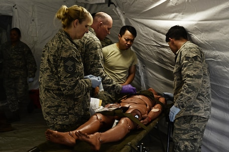 U.S. Army Reserve Soldiers, assigned to the 469th Medical Company-Ground Ambulance out of Wichita, Kansas, and Air Men, assigned to the 6th Medical Operations Squadron out of MacDill Air Force Base in Tampa, Fl., transport casualties from the point of drop off to the Air Force expeditionary medical support tent at forward operating base Nighthawk in Camp Atterbury, In., April 29, 2017, as part of Exercise Guardian Response. Nearly 4,100 Soldiers from across the country are participating in Guardian Response 17, a multi-component training exercise to validate U.S. Army units' ability to support the Defense Support of Civil Authorities (DSCA) in the event of a Chemical, Biological, Radiological, and Nuclear (CBRN) catastrophe. The 84th Training Command is the hosting organization for this exercise, with the training operations run by the 78th Training Division, headquartered in Fort Dix, New Jersey. (U.S. Army Reserve photo by Capt. Loyal Auterson)