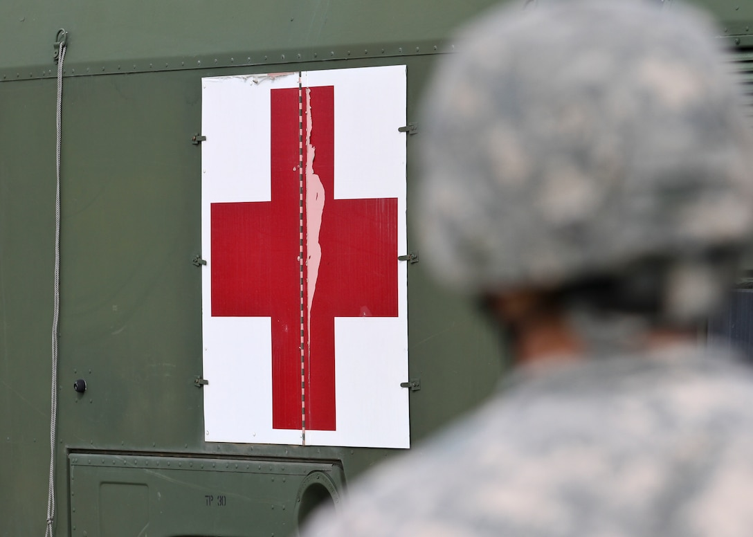 U.S. Army Reserve Soldiers, assigned to the 469th Medical Company-Ground Ambulance out of Wichita, Kansas, and Air Men, assigned to the 6th Medical Operations Squadron out of MacDill Air Force Base in Tampa, Fl., transport casualties from the point of drop off to the Air Force expeditionary medical support tent at forward operating base Nighthawk in Camp Atterbury, In., April 29, 2017, as part of Exercise Guardian Response. Nearly 4,100 Soldiers from across the country are participating in Guardian Response 17, a multi-component training exercise to validate U.S. Army units' ability to support the Defense Support of Civil Authorities (DSCA) in the event of a Chemical, Biological, Radiological, and Nuclear (CBRN) catastrophe. The 84th Training Command is the hosting organization for this exercise, with the training operations run by the 78th Training Division, headquartered in Fort Dix, New Jersey. (U.S. Army Reserve photo by Staff Sgt. Christopher Sofia)