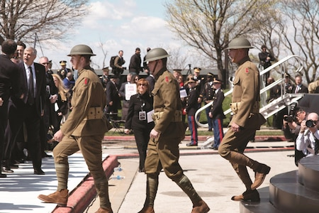"""Members of the 1st Infantry Division's Commanding General's Mounted Color Guard, dressed in World War I """"doughboy"""" uniforms, provided support to America's national ceremony commemorating the centennial of the United States entry into World War I April 6 at the National World War I Museum and Memorial in Kansas City, Missouri."""