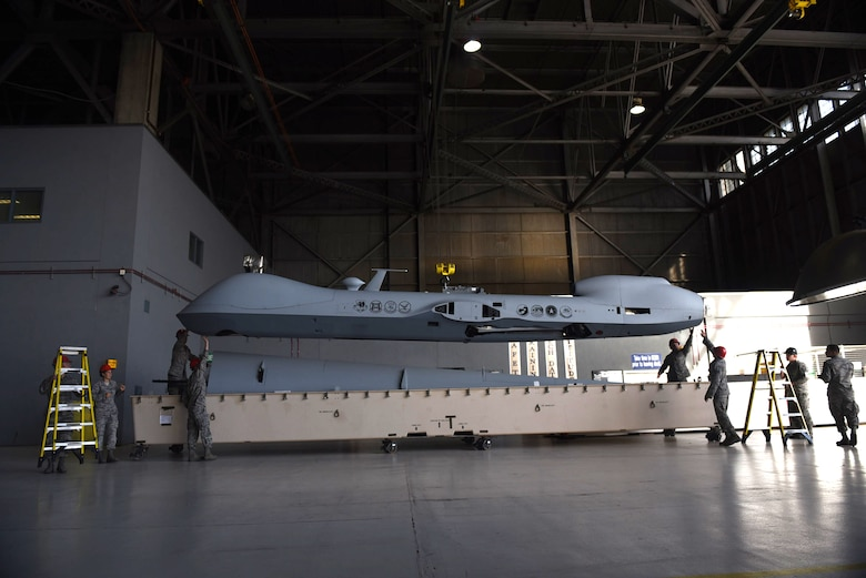 432nd Aircraft Maintenance Squadron maintainers unpack the MQ-9 Reaper model May 5, 2017, at Travis Air Force Base, Calif. The aircraft was displayed at the Wings Over Solano air show for spectators to see an actual MQ-9 and learn about the Reaper's capabilities. (U.S. Air Force photo/Senior Airman Christian Clausen