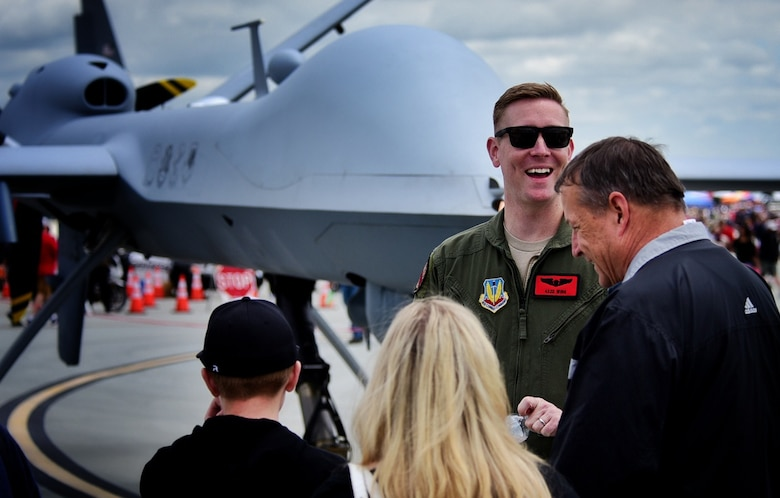 Tech. Sgt. Christopher, 867th Attack Squadron MQ-9 Reaper sensor operator, shares a laugh with spectators of the Wings Over Solano air show May 6, 2017, at Travis Air Force Base, Calif. Interacting with spectators gave MQ-9 crews the opportunity to dispel myths, provide information and explain the reaper mission. (U.S. Air Force photo/Senior Airman Christian Clausen)