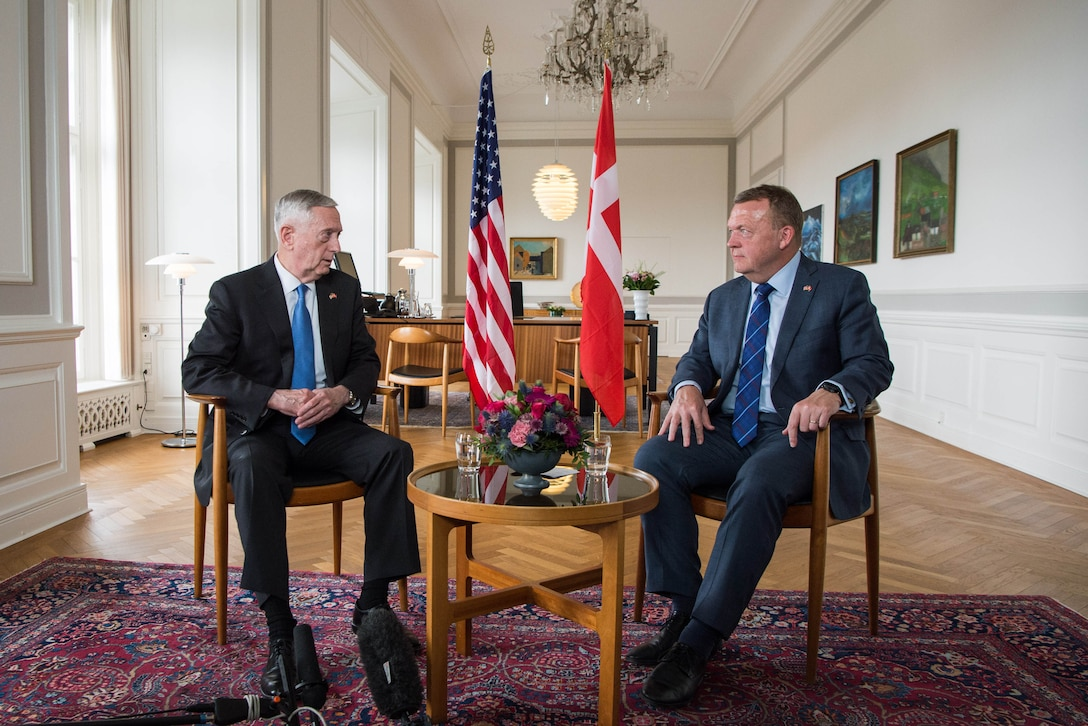 Defense Secretary Jim Mattis sitting with Danish Prime Minister Lars Løkke Rasmussen