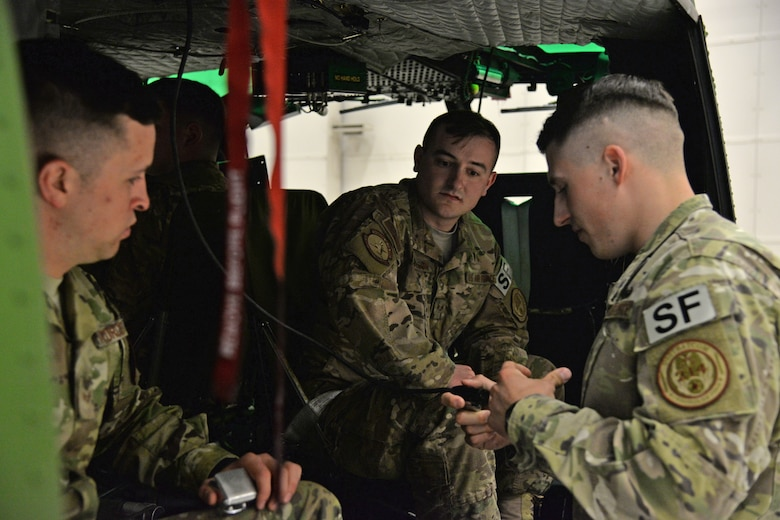 Staff Sgt. Jonathan Kitts, 741st Missile Security Forces Squadron Tactical Response Force flying program manager, right, briefs Senior Airmen Leif Olson, center, and Brandon Cooper, 741st MSFS Convoy Response Force defenders, on communications during joint fires observer training May 8, 2017, at Malmstrom Air Force Base, Mont. In order to provide safe, accurate and smooth communication, individuals must be able to control gun fire on the ground and provide near-perfect identification of targets and locations. (U.S. Air Force photo/Airman 1st Class Daniel Brosam)