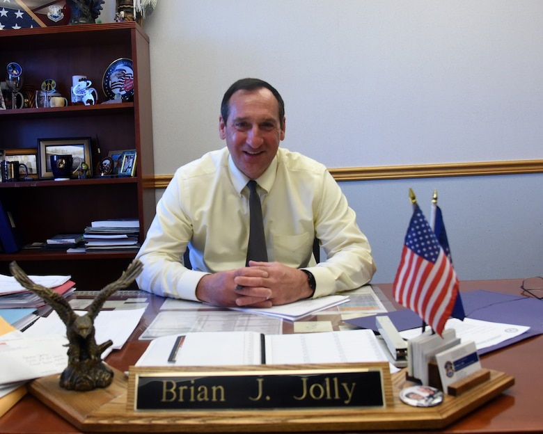 Brian Jolly, 341st Force Support Squadron manpower and personnel chief, poses at his desk May 8, 2017, at Malmstrom Air Force Base, Mont. Jolly retired from the Air Force as a chief after serving 29 years, and now uses those same leadership techniques to lead military and civilian personnel. (U.S. Air Force photo/Senior Airman Jaeda Tookes)