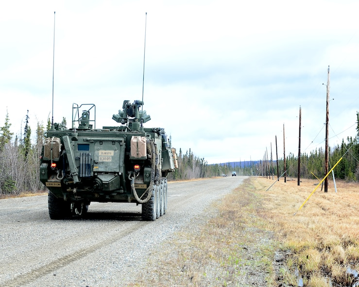 A U.S. Army M1135 Nuclear, Biological, Chemical Reconnaissance Vehicle, from the 1st Stryker Brigade Combat Team out of Fort Wainwright, Alaska, drives down a road during Operation Merlin Wing, May 5, 2017, at Eielson Air Force Base, Alaska. Operation Merlin Wing was a joint exercise between Air Force and Army chemical, biological, radiological and nuclear defense units, which also incorporated Air Force explosive ordnance disposal teams. (U.S. Air Force photo by Airman Eric M. Fisher)