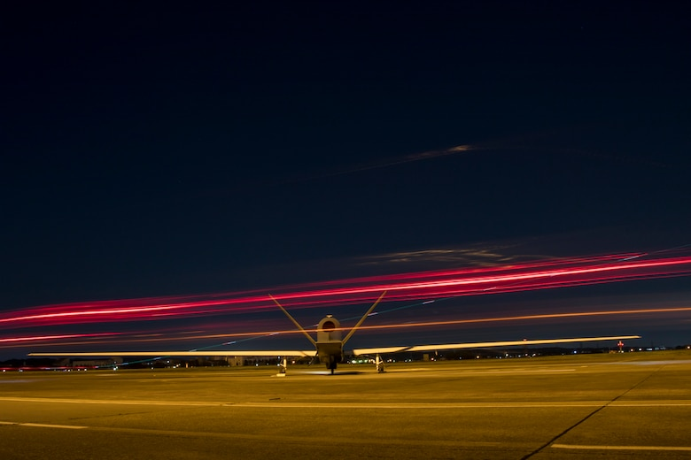 986b1ed80b An RQ-4 Global Hawk s engine warms up while planes take off and support  vehicles