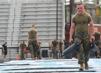 """Marines with first platoon, Guard Company, Marine Barracks Washington D.C., executed a """"surprise"""" training regimen at Johns Hopkins University, April 27, 2017. The training promotes team leadership, unit cohesion, and physical endurance. The regimen, designed and executed by the university's Head Strength and Conditioning Coach, Jay Dyer, consists of challenging workouts designed to condition Division One athletes prior to NCAA playoffs and national championships. Upon completion, the Marines were invited to tour the Johns Hopkins Lacrosse facilities in addition to watching the Varsity Men's Lacrosse practice. (Official Marine Corps photo by Lance Cpl. Damon Mclean/Released)"""