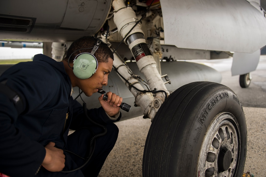 "Airman 1st Class Derek Larsen, 52nd Aircraft Maintenance Squadron assistant dedicated crew chief, inspects the tire of a U.S. Air Force F-16 Fighting Falcon assigned to the 480th Fighter Squadron during a ""14 front"" launch at Spangdahlem Air Base, Germany, May 4th, 2017. From April 24 to May 5, the 480th FS and 52nd Aircraft Maintenance Squadron supported 26 sorties a day, 14 in the morning and 12 in the afternoon. This flying tempo is referred to as a, ""14 turn 12,"" and is a 16 percent increase over normal operations. During normal operations, it's standard to launch a 12 turn 10, or 4 fewer sorties per day. Preparing and launching 14 aircraft in one go is referred to as a ""14 front."" (U.S. Air Force photo by Preston Cherry)"