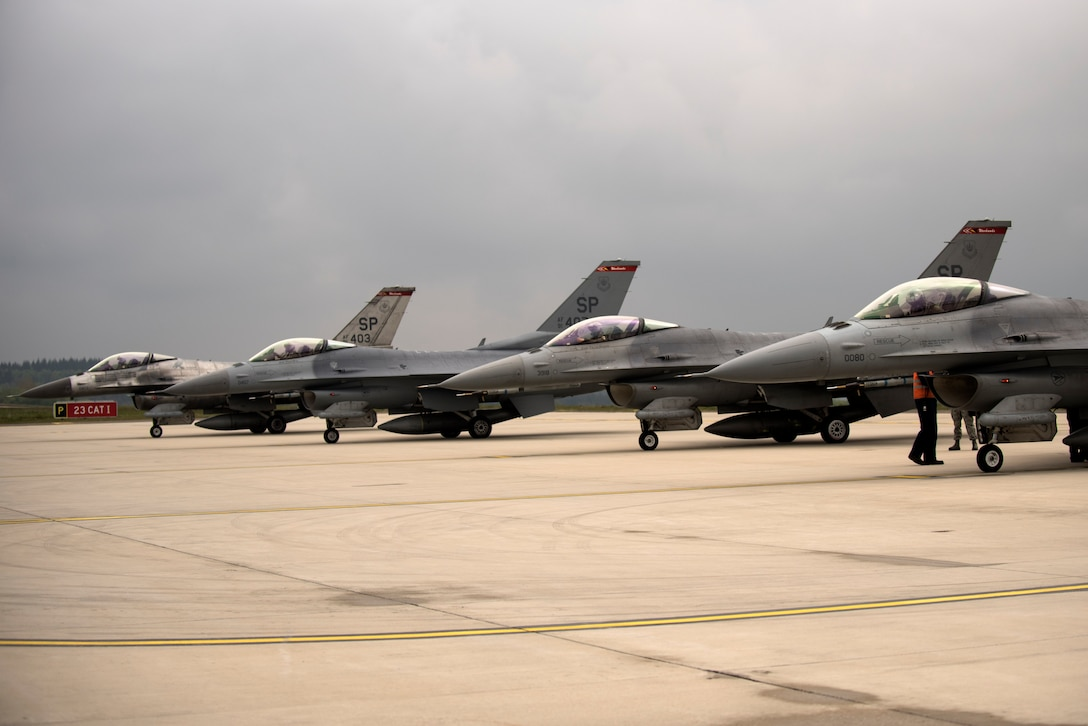 """U.S. Air Force F-16 Fighting Falcons assigned to the 480th Fighter Squadron wait for inspections during a """"14 front"""" launch at Spangdahlem Air Base, Germany, May 4th, 2017. From April 24 to May 5, the 480th FS and 52nd Aircraft Maintenance Squadron supported 26 sorties a day, 14 in the morning and 12 in the afternoon. This flying tempo is referred to as a, """"14 turn 12,"""" and is a 16 percent increase over normal operations. During normal operations, it's standard to launch a 12 turn 10, or 4 fewer sorties per day. Preparing and launching 14 aircraft in one go is referred to as a """"14 front."""" (U.S. Air Force photo by Preston Cherry)"""