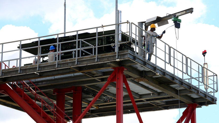 Airmen from the 606th Air Control Squadron install a new long-range radar, May 2, 2017 at Aviano Air Base, Italy. The radar equipment affords the squadron 240 nautical miles of visibility to control aircraft movements in northern Italy and parts of the Adriatic Sea.