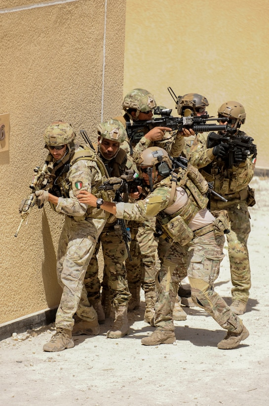 AMMAN, Jordan (May 8, 2017) Members of the U.S. Air Force Special Operation's 23 Special Tactics Squadron, Jordanian Armed Forces Special Task Force, and Italian Special Operations Wing, participating in small unit tactics, prepare to clear a building during drill at the King Abdullah II Special Operations Training Center, as part of Exercise Eager Lion. Eager Lion is an annual U.S. Central Command exercise in Jordan designed to strengthen military-to-military relationships between the U.S., Jordan and other international partners. This year's iteration is comprised of about 7,200 military personnel from more than 20 nations that will respond to scenarios involving border security, command and control, cyber defense and battlespace management. (U.S. Navy photo by Mass Communication Specialist 1st Class Matthew Cole/Released) 170508-N-ER662-174