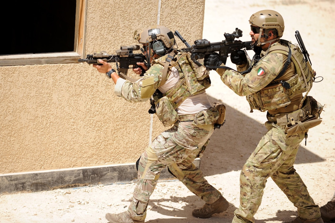 AMMAN, Jordan (May 8, 2017) Members of the U.S. Air Force Special Operation's 23 Special Tactics Squadron, and Italian Special Operations Wing, participating in small unit tactics, prepare to clear a building during drill at the King Abdullah II Special Operations Training Center, as part of Exercise Eager Lion. Eager Lion is an annual U.S. Central Command exercise in Jordan designed to strengthen military-to-military relationships between the U.S., Jordan and other international partners. This year's iteration is comprised of about 7,200 military personnel from more than 20 nations that will respond to scenarios involving border security, command and control, cyber defense and battlespace management. (U.S. Navy photo by Mass Communication Specialist 1st Class Matthew Cole/Released) 170508-N-ER662-199