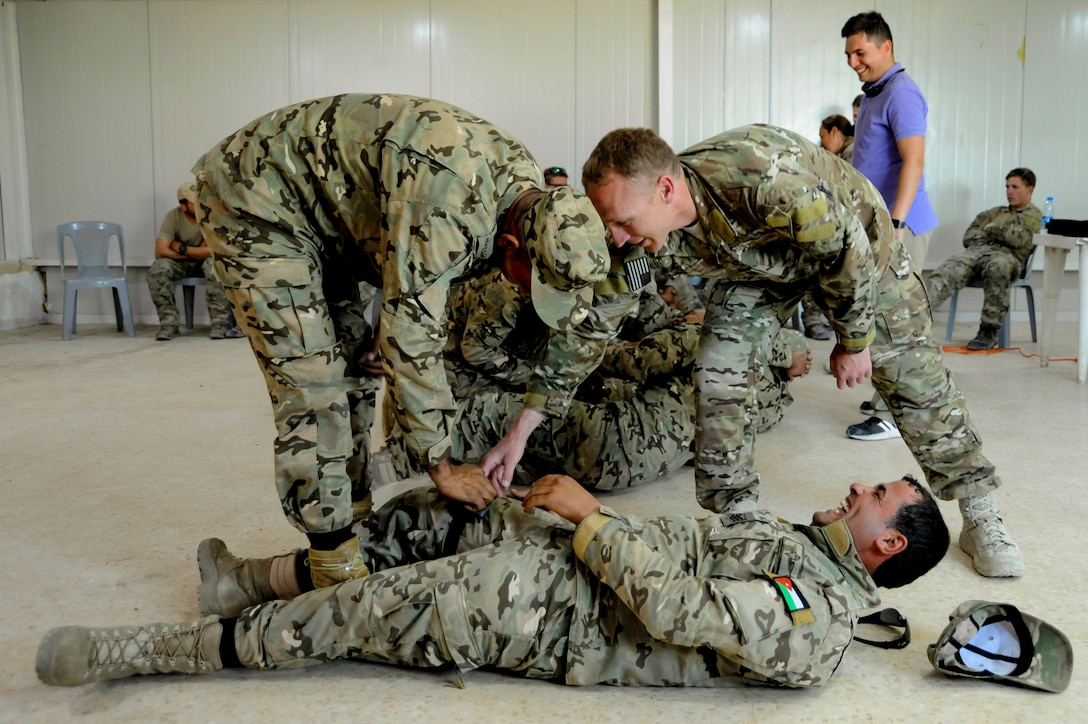 AMMAN, Jordan (May 8, 2017) Soldiers assigned to Jordanian Armed Forces Special Task Force 101, and Airmen assigned to U.S. Air Force Special Operation's 23 Special Tactics Squadron, participate in Tactical Combat Casualty Care training at the King Abdullah II Special Operations Training Center, as part of Exercise Eager Lion. Eager Lion is an annual U.S. Central Command exercise in Jordan designed to strengthen military-to-military relationships between the U.S., Jordan and other international partners. This year's iteration is comprised of about 7,200 military personnel from more than 20 nations that will respond to scenarios involving border security, command and control, cyber defense and battlespace management. (U.S. Navy photo by Mass Communication Specialist 1st Class Matthew Cole/Released) 170508-N-ER662-360