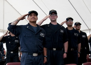 Sailors assigned to the Cyclone-class coastal patrol ship (PC) USS Whirlwind (PC 11) salute the ensign during the national anthem during the ship's change of command ceremony at Naval Support Activity Bahrain. The primary mission of the PCs is maritime security operations, and Whirlwind is one of 10 PCs forward deployed to Manama, Bahrain.