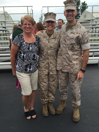 Candidate Elaine Lewis, center, poses with her parents during liberty at Marine Corps Officer Candidates School in Quantico, Virginia. Lewis, a 22-year-old native of Stafford, Virginia, is a senior at Virginia Tech and will graduate college May 12, 2017, and commission as a second lieutenant in the Marine Corps May 13, 2017. (Photo courtesy of Elaine Lewis)