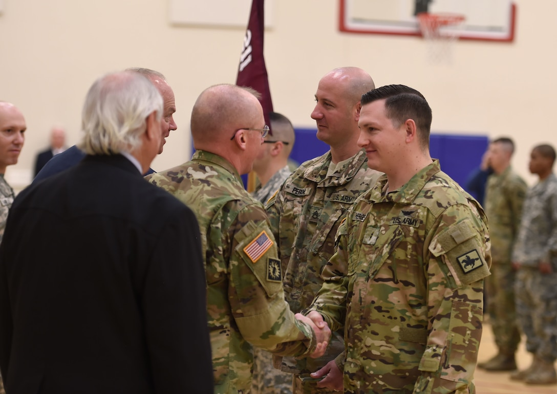 Wyoming Army National Guard soldiers Staff Sgt. Derrick Perkins, a medic, and Chief Warrant Officer 2 Bryan Herget, a UH-60 Black Hawk pilot, receive the Dustoff Association's Rescue of the Year award for their heroic effort that saved the lives of five critically wounded Soldiers during a medevac mission in Afghanistan in 2015.