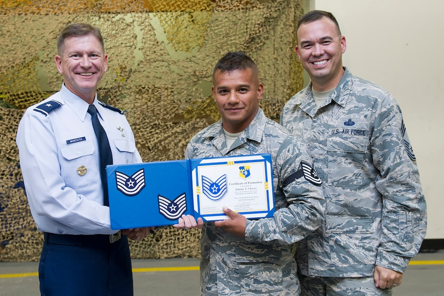 Brig. Gen. Wayne Monteith, 45th Space Wing commander, and Chief Master Sgt. Alexander Hall, 45th Space Wing interim command chief, (right), promote Staff. Sgt. Johnny Chavez, 45th Civil Engineer Squadron electrical systems craftsman, to the rank of technical sergeant as part of the Stripes for Exceptional Performers program, or STEP, May 9, 2017, at Patrick Air Force Base, Fla. The STEP program allows Air Force leaders to select Airmen with outstanding potential for promotion to the grades of staff sergeant through master sergeant, which occurs outside of a traditional promotion cycle. (U.S. Air Force photo by Phil Sunkel)