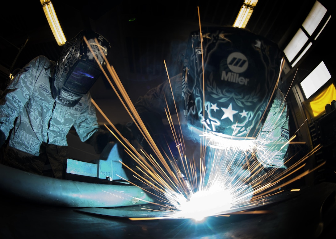 Airman 1st Class Joshua Roth, right, an 86th Maintenance Squadron aircraft metals technology technician, uses a metal insert gas welder while Staff Sgt. Brandon Didonato, also an 86th MXS aircraft metals technology technician, observes at Ramstein Air Base, Germany, May 2, 2017. Airmen assigned to the aircraft metals technology shop use a MIG welder to create sturdy aircraft parts on demand, allowing aircraft repair and maintenance to continue in a timely manner. (U.S. Air Force photo/Senior Airman Elizabeth Baker)