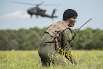 2nd Lt. Mark Pierce radios a rescue helicopter during the combined arms demonstration hosted by the South Carolina Guard Air & Ground Expo at McEntire Joint National Guard Base, South Carolina, May 6, 2017. This expo is to showcase the abilities of South Carolina National Guard Airmen and Soldiers while saying thank you for the support of fellow South Carolinians and the surrounding community. (U.S. Army National Guard photo/Sgt. Brian Calhoun)
